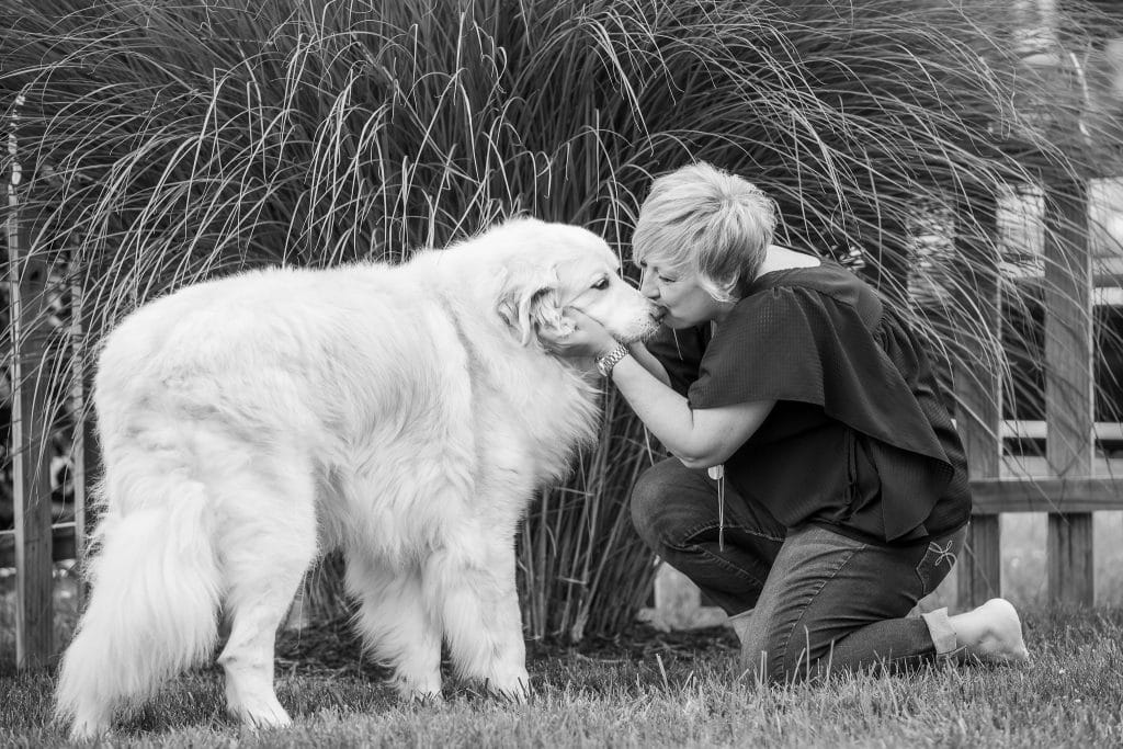 Kim Skillman kissing her dog Sebastian