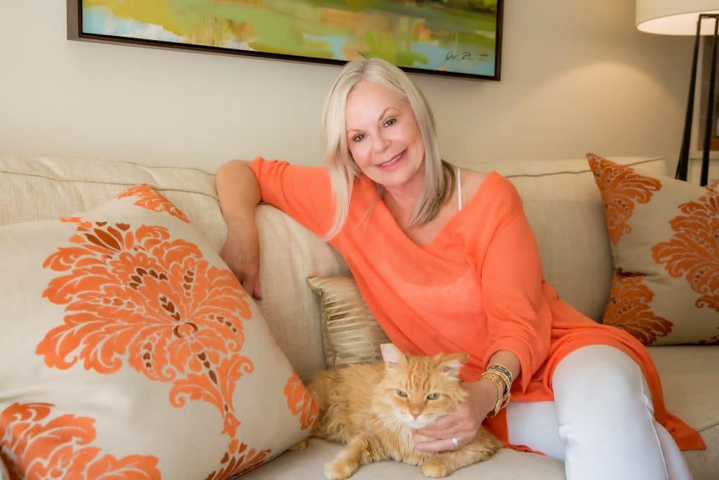 Portrait of Sande Riesett with her cat